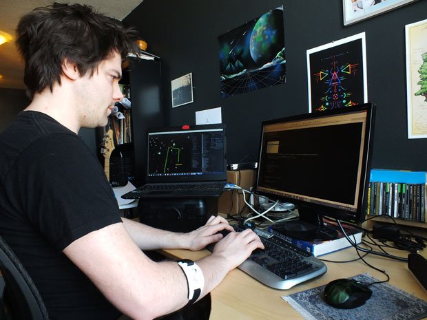Tyler Moore, founder of FrostFire Games does some coding from his work space at home